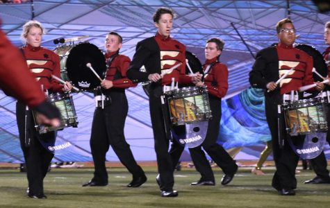 The Pride of Rock Island performs their show,