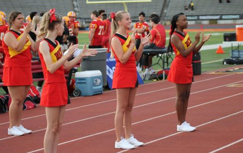 The freshmen cheerleading squad works hard to inspire the Rocks during a home game.