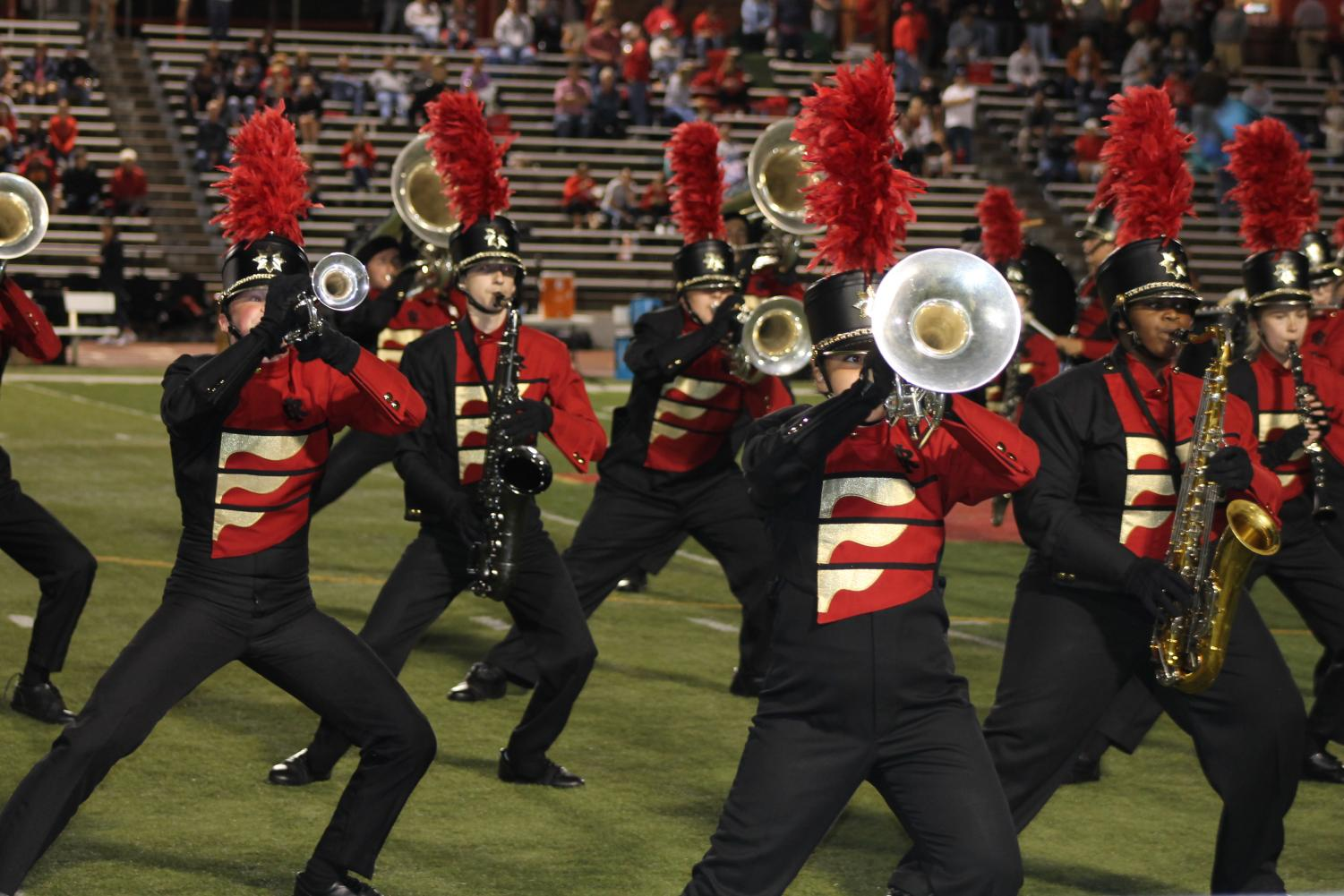 The Pride of Rock Island performs during halftime of the home football game.