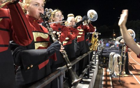 The Pride of Rock Island plays from the stands during home football games.
